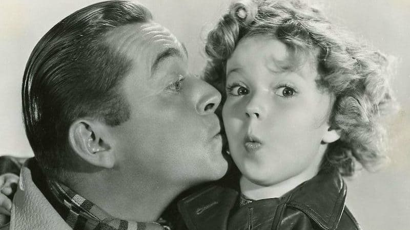 James Dunn and Shirley Temple publicity photo for Bright Eyes-front (cropped). Fox Film Corp publicity photo, Public domain, via Wikimedia Commons - for the famous kids trivia quiz Image