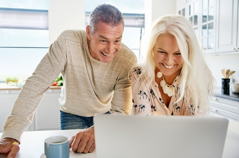 couple laughing at computer stefan dahl dreamstime - laughter, humor, funny
