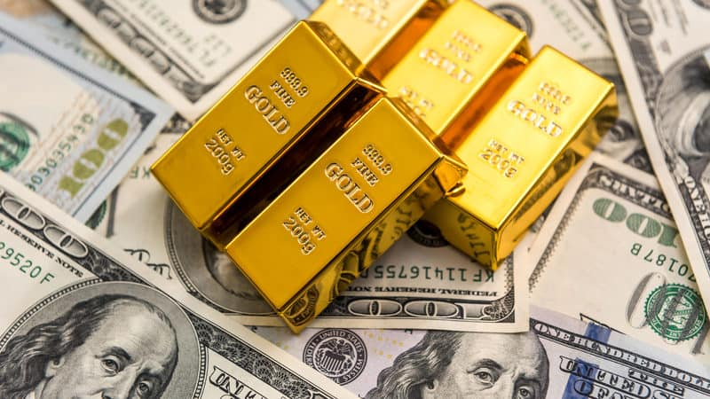 gold bullion ben franklins Roman Romaniuk Dreamstime. For article on family dinnertime discussion in 1971 Image