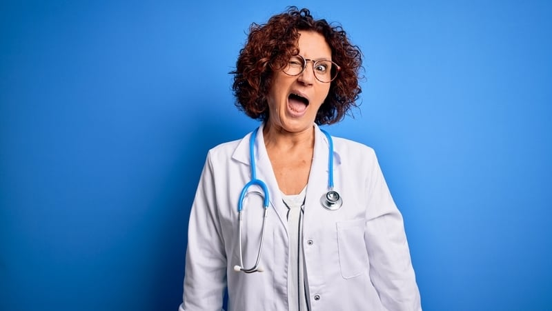 Sexy female doctor winking. For article on funny reasons not to date health professionals Image