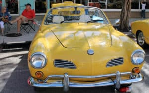 Vintage yellow VW Karmann Ghia cabriolet: for A Karmann Ghia and a boxing match Image