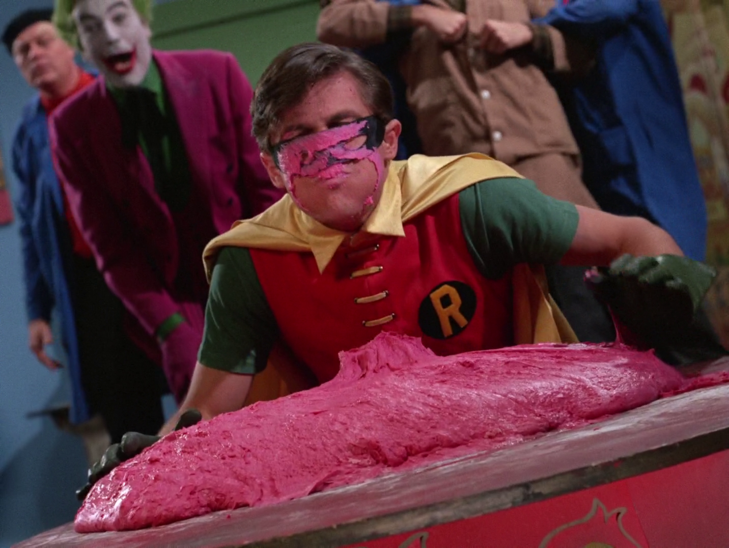Robin's face after it landed in the Joker's glob of pink clay