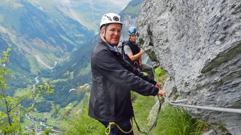 Buckled up as we embark on the via ferrata. CREDIT: Rick Steves, Rick Steves' Europe. For article on Mürren Via Ferrata in Switzerland Image