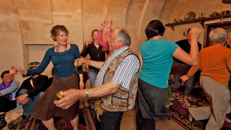Turkish family dancing at home. For article, Hospitality of a Turkish Family Home Image