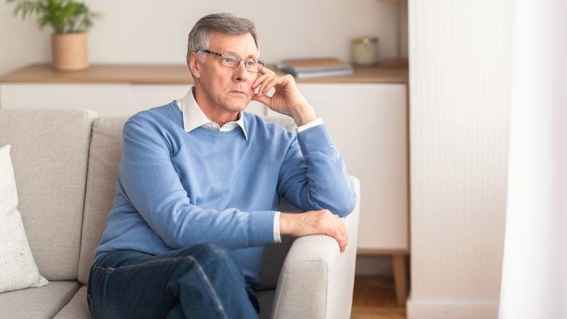 Senior man thinking about his Alzheimer's diagnosis Image