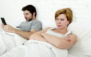 Insecure wife doesn't like all that texting! Image