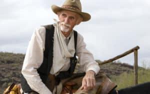 A rancher overlooks his herd Image