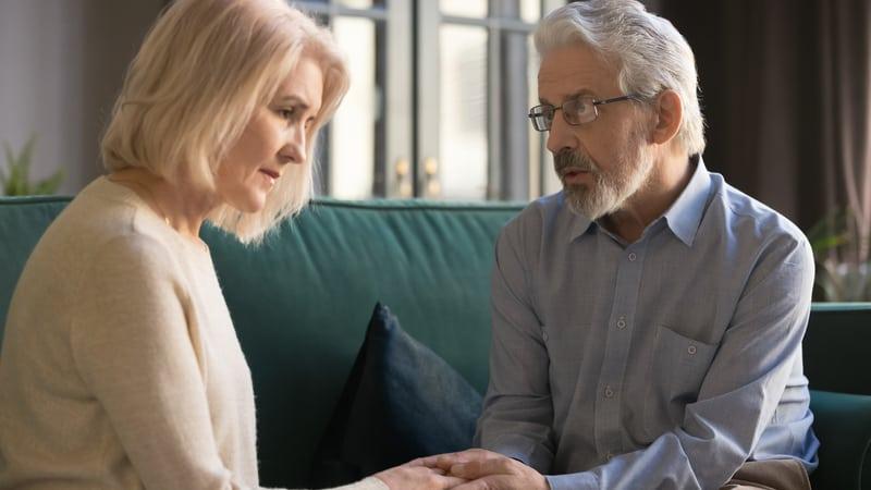 Senior man telling wife about surprise offspring Image