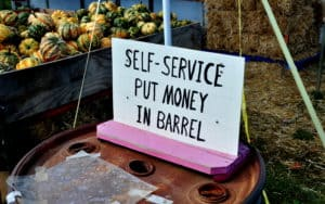 self service sign at a pumpkin farm stand. Photo by Lei Xu dreamstime. For article, The honor system still works Image