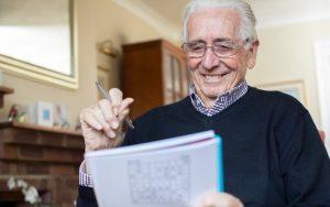 senior man doing puzzle. Image credit Katie Nesling Dreamstime.com Image