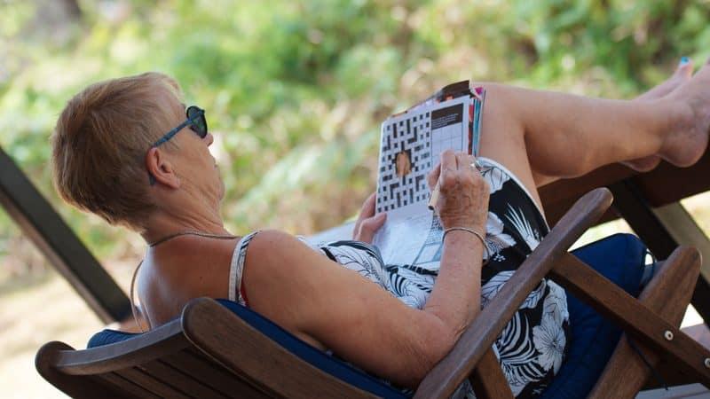 senior woman doing puzzle Rozenn Leard Dreamstime.com Image