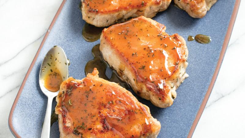 Apple cider-glazed pork chops Image