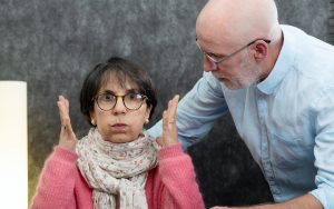 An elder couple with an exasperated woman. For article, Late-Life Romance with a Crook Image