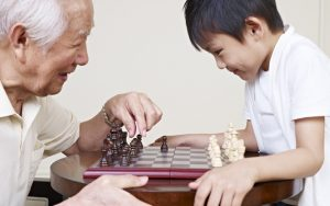 granddad and grandson playing chess game. Credit: Imtmphoto dreamstime Image