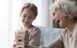grandmother granddaughter playing tower puzzle Fizkes Dreamstime Image