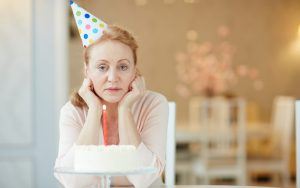 sad woman on her birthday (credit: Pressmaster Dreamstime.com) For article on When a birthday falls on a holiday Image